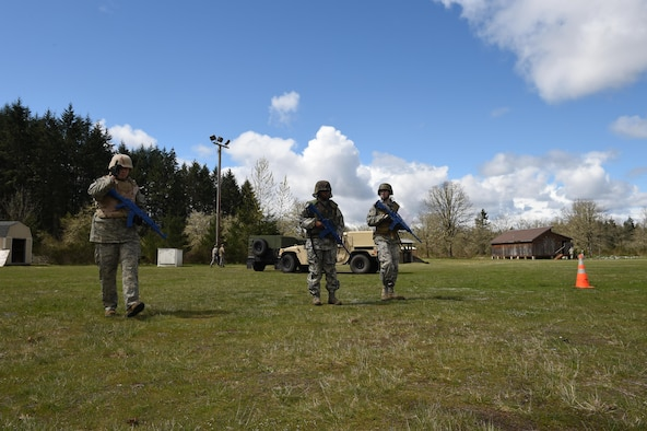 627th Civil Engineer Squadron Airmen use their land navigation training during their internal Capstone exercise April 20, 2017 at Joint Base Lewis-McChord, Wash. The capstone, which consisted of an evaluation where they simulated being in a deployed environment and had to build a base from the ground up in a contested environment, was used as an internal evaluation method tool to measure readiness for a year's worth of contingency training. (U.S. Air Force photo/ Staff Sgt. Naomi Shipley)