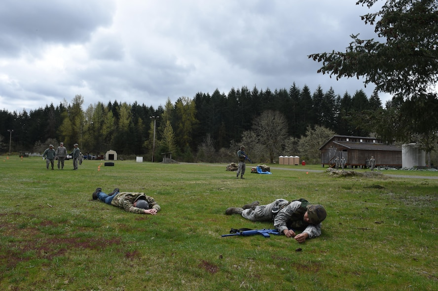 627th Civil Engineer Squadron Airmen simulate experiencing an attack by a suicide bomber during their internal Capstone exercise April 20, 2017 at Joint Base Lewis-McChord, Wash. The capstone was a validation of the unit's last several training days for the 627th CES have included land navigation training and air base defense training. (U.S. Air Force photo/ Staff Sgt. Naomi Shipley)