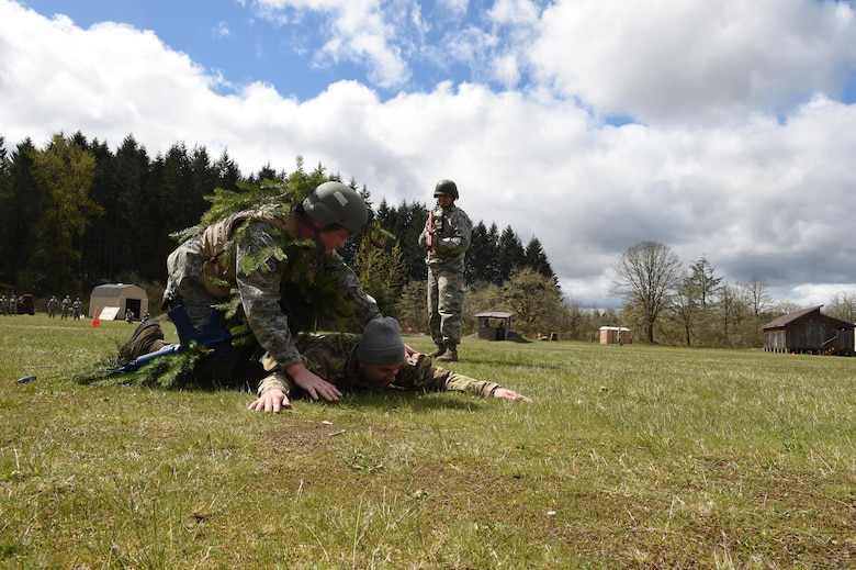 627th Civil Engineer Squadron Airmen use their air base defense training during their internal Capstone exercise April 20, 2017 at Joint Base Lewis-McChord, Wash. In the scenario several unidentified and hostile foreigners attempted to gain access to the base. (U.S. Air Force photo/ Staff Sgt. Naomi Shipley)
