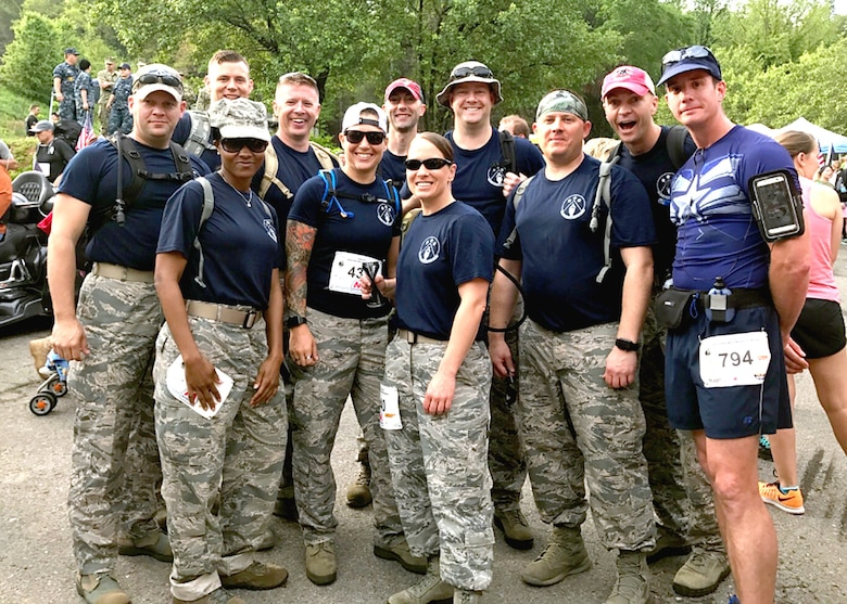 Eleven Airmen assigned with I.G. Brown Training and Education Center made their way 13.1 miles through Gatlinburg and into Tennessee's Smoky Mountains April 22 to complete the 10th Mountain Man Memorial March. Team TEC finished 2nd and Team AFSA finished 3rd in the military team light 13.1 division. One sergeant, who ran the half marathon, finished sixth overall. The annual 26.2, 13.1 and 10K run/march/ruck has since grown to be among the largest Gold Star Family events east of the Mississippi. (U.S Air National Guard photo courtesy Chief Master Sergeant Paul H. Lankford EPME Center)