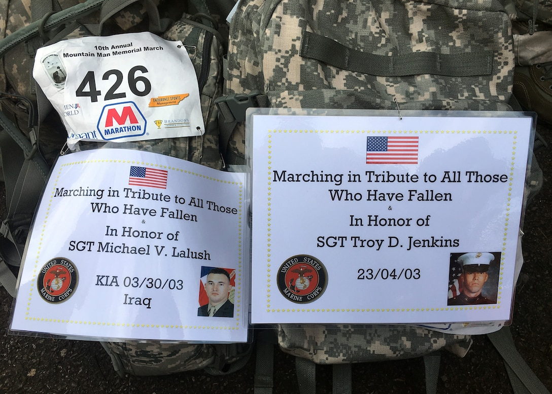 Placards with the names and photos of service members killed in action are pinned to entrants' gear for the Mountain Man Memorial March April 22 in Gatlinburg, Tenn. The annual 26.2, 13.1 and 10K run/march/ruck has since grown to be among the largest Gold Star Family events east of the Mississippi. (U.S Air National Guard photo courtesy Chief Master Sergeant Paul H. Lankford EPME Center)