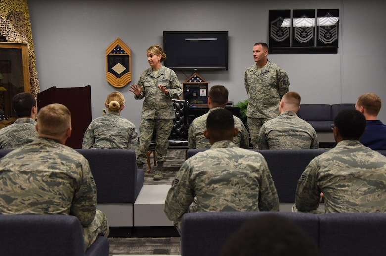 Col. Michele Edmondson, 81st Training Wing commander, briefs Airmen Leadership School students as Chief Master Sgt. Anthony Fisher, 81st Training Group superintendent, stands by inside the heritage room April 21, 2017, on Keesler Air Force Base, Miss. Edmondson visits every ALS class to brief the importance of fulfilling a leadership role. (U.S. Air Force photo by Kemberly Groue)