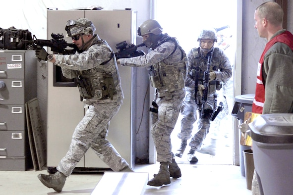 From the left, Tech. Sgt. Mark Hudson, Tech. Sgt. Kenneth Willingham and Senior Airman Jesus Reuda, all 75th Security Forces Squadron, burst into building 732 at Hill Air Force Base, April 24. The Airmen were participating in an active shooter response exercise. (U.S. Air Force/Todd Cromar)