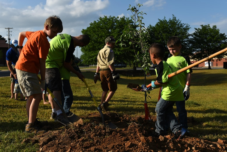 Cub Scouts Pack 170 plant a fruit tree April 19, 2017, near the Jacksonville Lighthouse Charter School: Flightline Upper Academy on Little Rock Air Force Base, Ark. Little Rock AFB continually partners with the community to maintain and plant its growing population of urban trees. (U.S. Air Force photo by Senior Airman Mercedes Taylor)