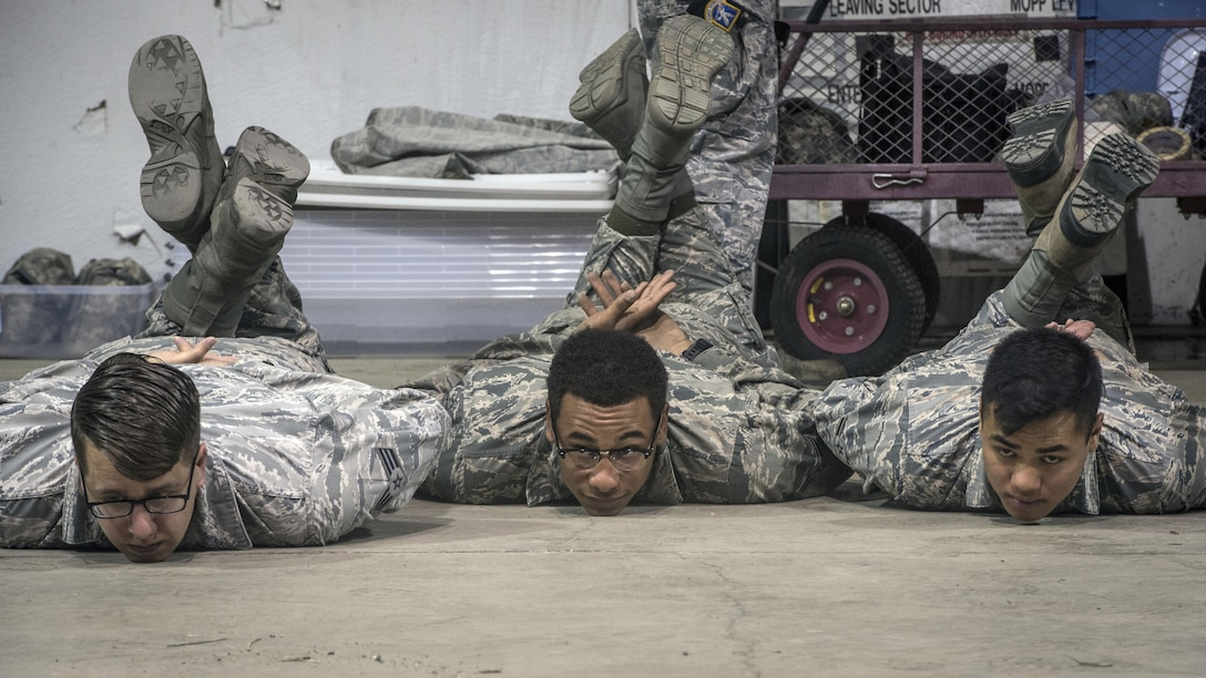 From the left, Senior Airman Alexander Sheridan, Airman 1st Class Dijon Edwards and Airman Vincent Duller, all 775th Civil Engineer Squadron, are detained as unknown individuals during an active shooter response exercise April 24 at Hill Air Force Base.  (U.S. Air Force/Paul Holcomb)