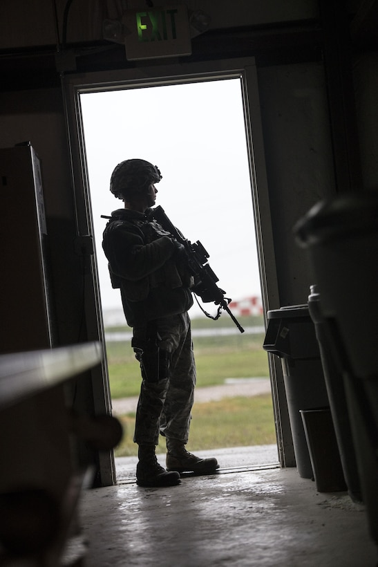A 75th Security Forces Squadron Airman stands guard at the west entrance to building 732 during an active shooter and explosives response exercise at Hill Air Force Base, April 24. (U.S. Air Force/Paul Holcomb)
