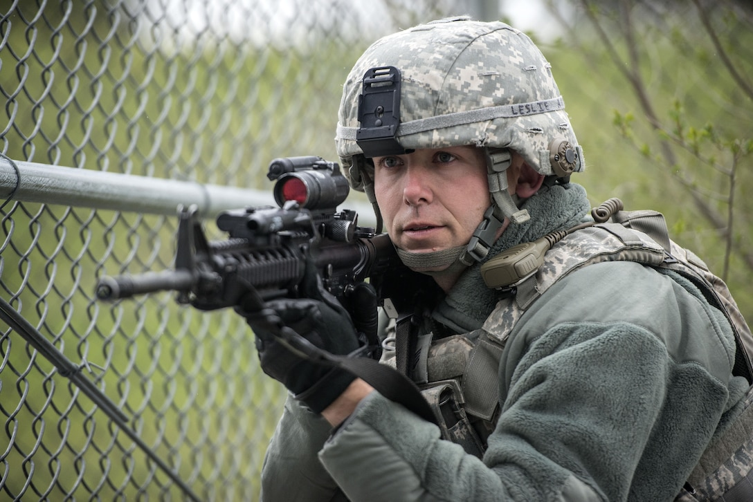 Staff Sgt. Richard Leslie, 75th Security Forces Squadron, responds to a report of an active shooter and explosives during a response exercise at building 732, Hill Air Force Base, April 24. (U.S. Air Force/Paul Holcomb)