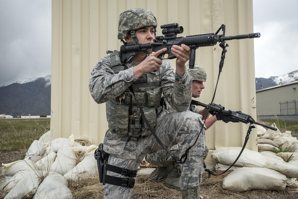 Senior Airman Dwight Gomes, foreground, and Staff Sgt. Jacob Sime, both 75th Security Forces Squadron, respond to a report of an active shooter and explosives during a response exercise at building 732, Hill Air Force Base, April 24. (U.S. Air Force/Paul Holcomb)