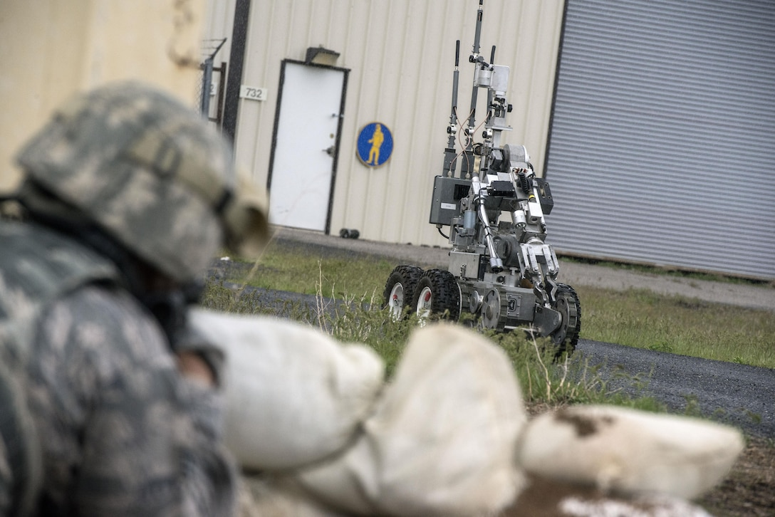 An Explosive Ordnance Disposal robot returns to the EOD response vehicle after inspecting a mock homemade device at the base of a door on the west side of building 732, Hill Air Force Base, April 24. Airmen from the 75th Security Forces Squadron and 775th EOD Flight participated in an active shooter and explosives response exercise. (U.S. Air Force/Paul Holcomb)