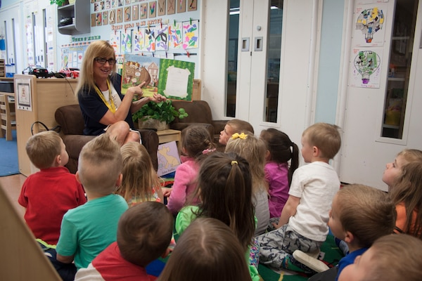 """DLA Distribution commander Army Brig. Gen. John S. Laskodi's wife Ursula reads """"There's a Lion in my Cornflakes"""" to one of the classrooms at the Defense Distribution Center Susquehanna Child Development Center, in honor of Month of the Military Child on April 19."""