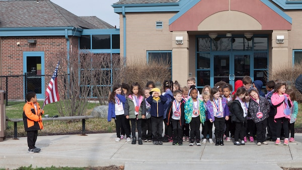 Children of the Defense Distribution Center Susquehanna Child Development Center recite the National Anthem in honor of Month of the Military Child.