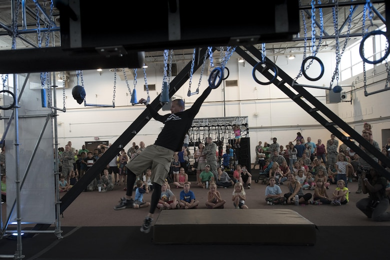 Brent Steffensen, Alpha Warrior team member, swings through the Alpha Warrior obstacle course, April 26, 2017, at Moody Air Force Base, Ga. The Air Force Services Activity partnered with the Alpha Warrior team to promote Comprehensive Airman Fitness. Winners earned an opportunity to compete in an Air Force-wide Alpha Warrior championship.  (U.S. Air Force photo by Airman 1st Class Daniel Snider)