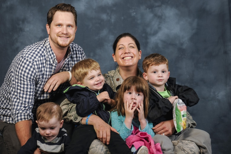 The Christi family poses for a photo at Joint Base Andrews, Md., April 27, 2017. Michael Christi, far right, son of Jeff Christi and Maj. Rebecca Christi, 799th Medical Group pediatrician, has autism spectrum disorder. The Air Force provides Michael with health and educational services, including Exceptional Family Member Program and Extended Care Health Options, which in turn provide therapies such as applied behavior analogy, speech therapy, and occupational therapy. April is also Autism Awareness Month, which is meant to increase understanding and acceptance of autism. (U.S. Air Force photo by Airman 1st Class Valentina Lopez)