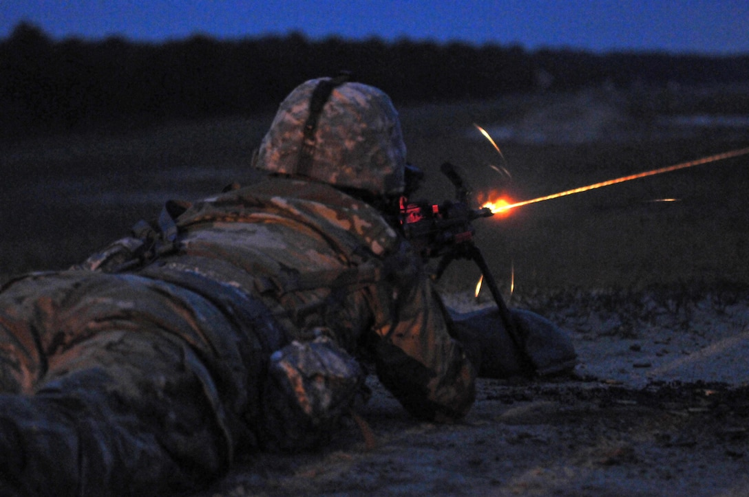 A U.S. Army Reserve Soldier engages a target with a Squad Automatic Weapon (SAW) during the Combined Best Warrior Competition SAW Night Qualification on Joint Base McGuire-Dix-Lakehurst, N.J. April 26, 2017. Contestants hopefully take the title of Best Noncommissioned Officer and Best Soldier and move on to represent the 412th Theater Engineer Command,  416th Theater Engineer Command and 76th Division (Operational Response) at the USARC Best Warrior Competition. (U.S. Army Reserve Photo by Sgt. 1st Class Clinton Wood)