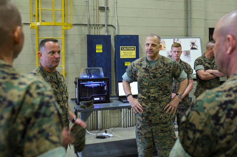 Lieutenant Gen. Michael Dana watches a demonstration of Combat Logistics Regiment 25's 3D printer during a visit to Camp Lejeune, N.C., March 13, 2017. The 3D printer is able to make replicas of equipment that is mission critical. Dana is the Deputy Commandant of Installation and Logistics. (U.S. Marine Corps photo by Cpl. Ashley Lawson)
