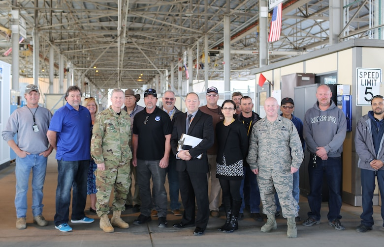 After recognizing the 309th Aerospace Maintenance and Regeneration Group for their contribution to the MC-130H and AC-130 sustainment program, Maj. Gen. Gregory Ferguson, the Air National Guard Assistant to the Commander, Air Force Special Operations Command, meets with the team credited with the C-130 outer wing refurbishment program. From left, James Courson, Robert Cappell, Caroline Sturm, Maj. Gen. Ferguson, Loren Higgins, Dave Lang, Tony Draper, Timothy Gray, Mark Perrodin, Shirley Mercier, Chris Watkins, Scott McClure, Lt. Col. Daniel Willison, Binh Tran, Richard Barrett and Mathew Tucker. (U.S. Air Force photo)