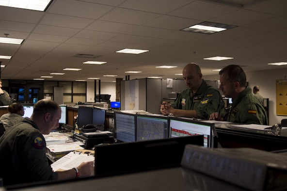 Maj. Jaime, a Spanish air force student pilot, right, and Staff Sgt. Francisco, a Spanish air force student sensor operator, middle, listen to a briefing given by a 29th Attack Squadron MQ-9 Reaper instructor pilot at Holloman Air Force Base, N.M. on April 5, 2017. Spain is currently participating in essential training here at the MQ-9 formal training unit. (U.S. Air Force photo by Tech. Sgt. Amanda Junk)