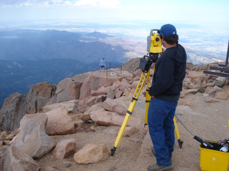 Field surveyor Ryan King performs topographic a survey for renovation project at the Pikes Peak Visitor Center.