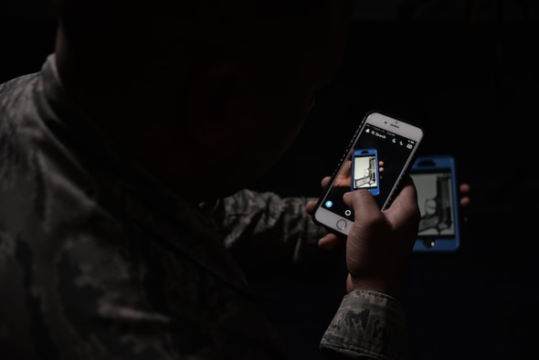 An Airman with the 301st Intelligence Squadron, Joint Base Elmendorf-Richardson, Alaska, may have averted a tragedy with his quick thinking, creative use of technology and drive to do the right thing. An Airman 1st Class, administrative apprentice, alerted the appropriate officials when he received a text message from his sibling regarding an alarming social media video. The video showed a Hallandale Beach High School, Miami, Florida, student wielding a handgun with a loaded magazine during a pep rally.  A Code Red was immediately initiated and the school was locked down. (U.S. Air Force photo/Staff Sgt. Alexandre Montes)