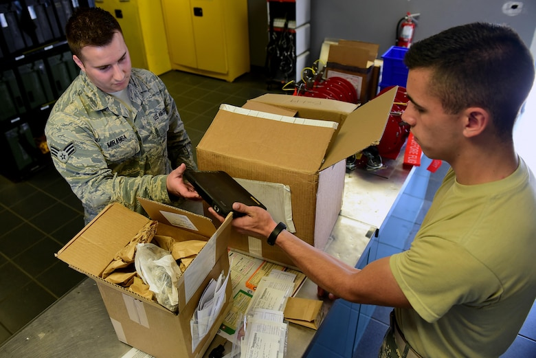 Senior Airman Kevin Miranda, 4th Component Maintenance Squadron aircraft fuel systems journeyman (left), signs for parts April 27, 2017, at Seymour Johnson Air Force Base, North Carolina. Airman 1st Class Brandon Ferguson, 4th Logistics Readiness Squadron driver (right), delivers an average of 200 parts per day across base. (U.S. Air Force photo by Airman 1st Class Kenneth Boyton)
