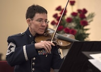 Chief Master Sgt. Deborah R. Volker, U.S. Air Force Band Strings flight chief and violinist, performs during the Holocaust Commemoration at Joint Base Andrews, Md., April 26, 2017. The memorial featured an invocation, prayers and a speech made by Dr. Alfred Münzer, Holocaust survivor. (U.S. Air Force photo by Senior Airman Jordyn Fetter)