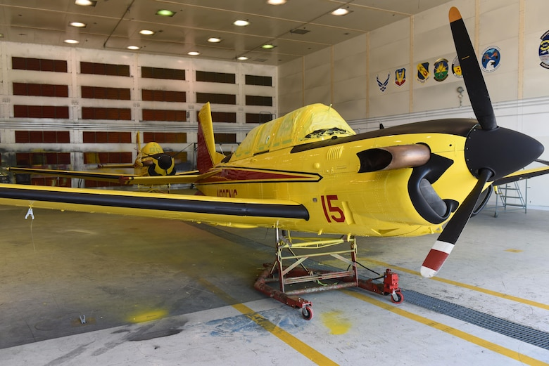 Freshly painted North Carolina Forest Service aviation division T-34C Turbo Mentors sit in the 4th Equipment Maintenance Squadron corrosion control shop, April 21, 2017, at Seymour Johnson Air Force Base, North Carolina. The two turbine powered T-34Cs replaced the piston powered T-34B Mentor lead aircraft previously used by the NCFS. (U.S. Air Force photo by Airman 1st Class Ashley Williamson)