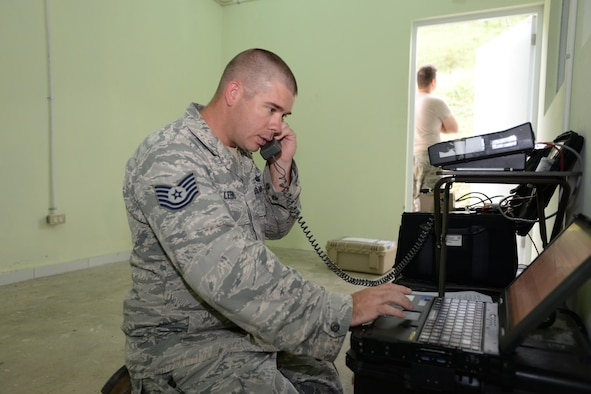 U.S. Air Force Tech. Sgt. Philippe LeBrun, the 51st Combat Communications Squadron (CCS) radio frequency transmission systems noncommissioned officer in charge, out of Robins Air Force Base, Ga., works on a computer in support of NEW HORIZONS 2017 in Arroyo Cano, Dominican Republic, April 24, 2017. Airmen with the 51st CCS train to provide the initial communications for a bare base setup such as the one used by U.S. service members during NH17. (U.S. Air Force photo by Staff Sgt. Timothy M. Young)