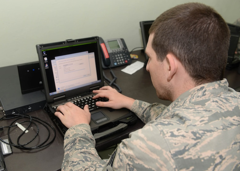 U.S. Air Force Senior Airman Joshua Marsh, a cyber systems operator with the 51st Combat Communications Squadron out of Robins Air Force Base, Ga., fixes a software problem on a government laptop during NEW HORIZONS 2017 in Arroyo Cano, Dominican Republic, April 13, 2017. Both software and hardware must be properly maintained in order to stay fully operational. (U.S. Air Force photo by Staff Sgt. Timothy M. Young)
