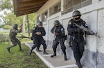 Police and soldiers in Guatemala prepare to enter a building during a U.S. Army-supported evaluation exercise to train the Guatemalan forces to be better prepared to combat illegal drug trafficking operations, Jupiata, Guatemala, June 16, 2016. U.S. Southern Command officials highlighted at the April 24-25, 2017, Central America Security Conference in Cozumel, Mexico, how the United States is working to strengthen capabilities and hone skills of its Central American partners to confront the well-financed and well-equipped transnational criminal groups. Air Force photo by Tech. Sgt. Trevor Tiernan