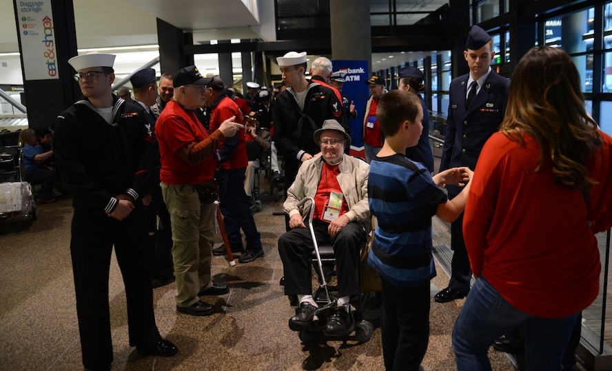 Service members entertain veterans participating in the Puget Sound Honor Flight April 24, 2017, at Seattle-Tacoma International Airport Seattle, Wash. The veterans were welcomed home after returning from their trip to Washington, District of Columbia to see monuments built in their honor, such as the World War II Memorial. (U. S. Air Force photo/Senior Airman Jacob Jimenez)
