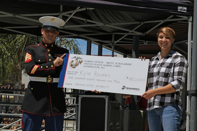 Sergeant Brian Robert, recruiter of Recruiting Sub Station Ventura, presents a Naval Reserve Officers Training Corps Scholarship check to Kyla Rosales at Foothill Technology High School in Ventura, Calif., April 26, 2017. The NROTC scholarship, valued at up to $180,000, will pay for the cost of full tuition, books and other educational fees at many of the country's leading colleges and universities. (U.S. Marine Corps photo by Staff Sgt. Alicia R. Leaders/Released)