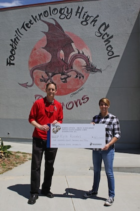 Foothill Technology High School Principal Joe Bova and Kyla Rosales pose for a photo after Sergeant Brian Robert, recruiter of Recruiting Sub Station Ventura, presented a Naval Reserve Officers Training Corps Scholarship check to Kyla at the high school, April 26, 2017. (U.S. Marine Corps photo by Staff Sgt. Alicia R. Leaders/Released)