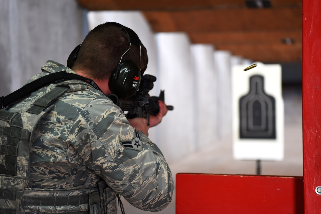 Airman 1st Class Nicholas Rauch, 460th Security Forces Squadron member, participates in the weapons qualification portion of the Emergency Services Team tryouts, March 10, 2017, on Buckley Air Force Base, Colo. The tryouts consisted of a timed obstacle course, an interview and a weapons qualification. The course was made up of a half-mile uphill run, followed by dragging a 90-pound dummy 50 meters, then sprinting about 100 meters where a jammed door needed to be  opened using a battering ram, and finally each contestant finished with five burpees. This was all completed while wearing gear that weighed roughly 40 pounds. (U.S. Air Force photo by Airman 1st Class Holden S. Faul/ Released)