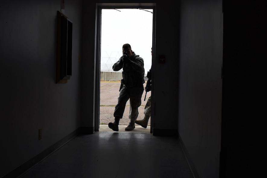 Airman 1st Class Alexander Warren, 460th Security Forces Squadron member, leads his Emergency Services Team into a possible hostage scenario during training Apr. 21, 2017, on Buckley Air Force Base, Colo. This is the first EST Buckley AFB has had, and it's members are dedicated to train until they feel prepared for any given situation. (U.S. Air Force photo by Airman 1st Class Holden S. Faul/ Released)
