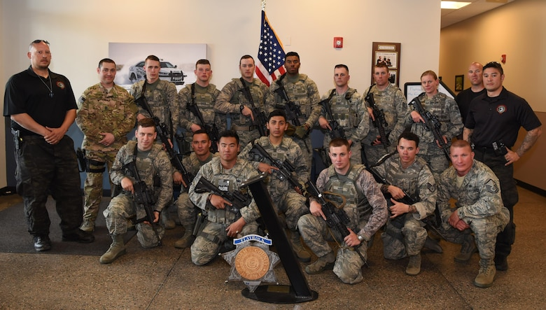Members from the 460th Security Forces Squadron, the 302nd SFS and Adams County Sheriff Department pose for a group photo Apr. 23, 2017, at the Flatrock Regional Training Center in Commerce City, Colo. Adams County Sheriff Department Special Weapons and Tactics team spent three days training the 460th SFS Emergency Services Team in tactical movements for several possible scenarios. (U.S. Air Force photo by Airman 1st Class Holden S. Faul/ Released)