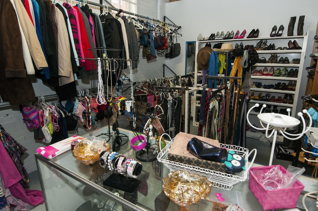 Woman's clothes and accessories are on display at the Airman's Attic on F.E. Warren Air Force Base, Wyo., April 26, 2017. All items are free at the attic, and members who use the facility are only asked to not resale the items they take. The Airman's Attic is a base resource where Airmen, dependents and retirees can shop for free through donated goods. (U.S. Air Force photo by Staff Sgt. Christopher Ruano)
