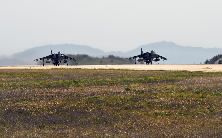 U.S. Marine Corp AV-8B Harriers with Marine Attack Squadron (VMA) 311 prepare for takeoff during Exercise MAX THUNDER 17 at Kunsan Air Base, Republic of Korea, April 27, 2017. In Max Thunder, U.S. and ROK air forces consistently train together to be ready around-the-clock to defend the Republic of Korea. The interoperability and trust developed between the allies in training is critical to ensure we are prepared for any challenge. (U.S. Air Force photo by Tech. Sgt. Jeff Andrejcik/Released)