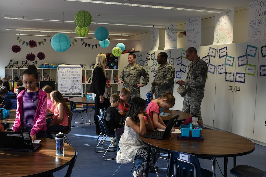 Col. Steven Horton, 52nd Fighter Wing vice commander and other members of wing leadership speak with a Spangdahlem Elementary School teacher in a new modular classroom at Spangdahlem Air Base, Germany, April 26, 2017. The modular unit now allows for all elementary school students to be educated on Spangdahlem AB. Previously, elementary age students were split between here and Bitburg AB. (U.S. Air Force photo by Senior Airman Dawn M. Weber)