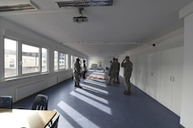 52nd Fighter Wing leadership receive a tour of the new modular classrooms from Angelique Lamonski, Principal of Spangdahlem Elementary School at Spangdahlem Air Base, Germany, April 26, 2017. The modular unit now allows all elementary school students to be educated on Spangdahlem AB. Previously, elementary age students were split between here and Bitburg AB. (U.S. Air Force photo by Senior Airman Dawn M. Weber)
