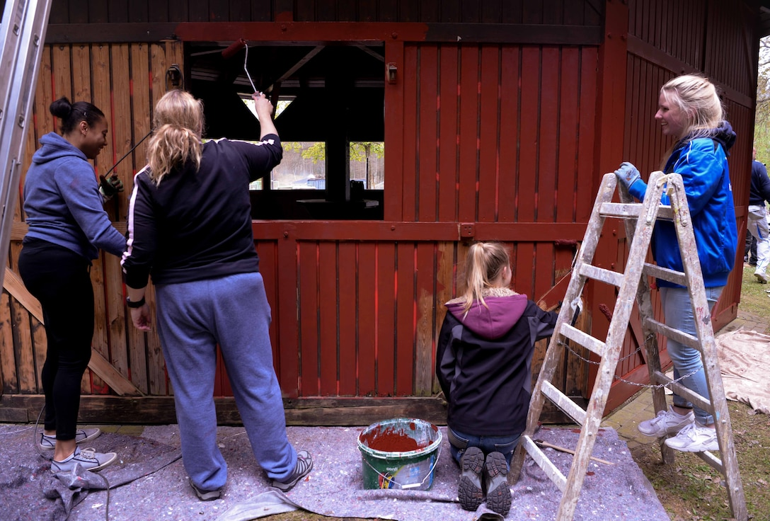 Volunteers from Ramstein Airbase and the town of Schwedelbach work together to repair a public barbecue pavilion in Schwedelbach, Germany, April 23, 2017. Airmen and local nationals teamed up through the 86th Airlift Wing Host Nations Office's Grassroots Program for Single Airmen to repair and beautify a public facility. The program aims to foster community and cross-cultural understanding between Airmen and the local community. (U.S. Air Force photo by Senior Airman Elizabeth Baker)