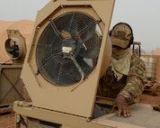 Staff Sgt. Julian Johnson, 768th Expeditionary Air Base Squadron NCO in charge of Heating Ventilation and Air Conditioning, opens the top of an HVAC unit at Nigerien Air Base 101, Niger, April 3, 2017. While cleaning the units, HVAC members spray the inside and outside of units, pull out and clean the air filters, and perform a systems check once finished. (U.S. Air Force photo by Senior Airman Jimmie D. Pike)