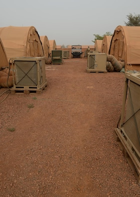 Heating Ventilation and Air Conditioning units operate behind tents at Nigerien Air Base 101, Niger, April 3, 2017. There are approximately 120 HVAC units that supply air conditioning to U.S. facilities on the base. (U.S. Air Force photo by Senior Airman Jimmie D. Pike)