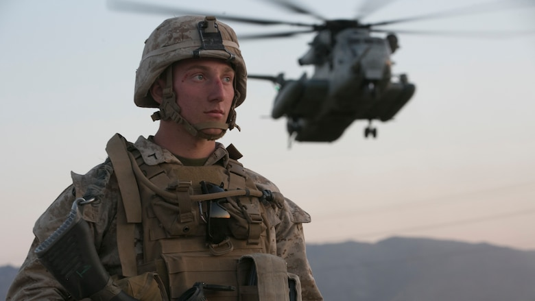 Pfc. Benjamin Kelly, machinegunner, 2nd Battalion, 6th Marine Regiment, provides security as a CH-53 'Super Stallion' helicopter lands at Del Valle Field during a non-combatant Evacuation Operation exercise as part of Weapons and Tactics Instructor Course 2-17 at Marine Corps Air Ground Combat Center Twentynine Palms, Calif., April 21, 2017. NEO exercises simulate real-life scenarios where non-combatants are evacuated from a potentially hostile area.
