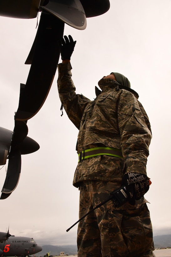 Air National Guard Staff Sgt. Joseph Perez from the 146th Maintenance Squadron inspects the propeller of a C-130J Super Hercules aircraft at Gowen Field, Idaho, April 20, 2017. Perez, along with a maintenance crew from the 146th Airlift Wing, will be providing maintenance service on two C-130J aircraft equipped with the Modular Airborne Fire Fighting System from the Channel Islands Air National Guard Station during the week-long multi-agency wildfire training with the U.S. Forest Service, CAL FIRE, and multiple Air National Guard and Air Force Reserve wings. (U.S. Air National Guard photo/Staff Sgt. Nieko Carzis)