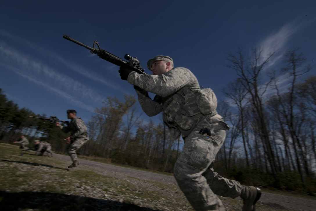 Airmen from the New Jersey Air National Guard's 108th Security Forces Squadron practice squad tactics and danger crossing techniques at Joint Base McGuire-Dix-Lakehurst, N.J., April 23, 2017. (U.S. Air National Guard photo/Master Sgt. Matt Hecht)