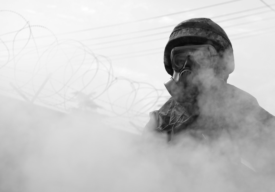 A South Korean airman assists with decontamination operations during the South Korea/U.S. combined chemical, biological, radiological and nuclear field training exercise at Daegu Air Base, April 20, 2017. The exercise was coupled with the U.S./South Korea combined airfield damage repair exercise and included classroom study as well as detection and decontamination scenarios. (U.S. Air Force photo/Staff Sgt. Alex Fox Echols III)