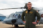 Navy Lt. Adam Patterson stands in front of one of the MH-60S Seahawk helicopters he flies as a pilot with Naval Air Station Patuxent River's search-and-rescue team, at NAS Patuxent River, Md., April 14, 2017. Patterson's Navy career has taken him above and below the sea. Navy photo by Petty Officer 1st Class Patrick Gordon