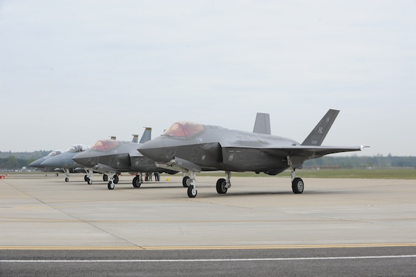 Two F-35As and two F-15Cs wait at the end of the runway at RAF Lakenheath prior to a training sortie. Airmen from the 388th and 419th Fighter Wings at Hill Air Force Base, Utah, deployed the F-35A overseas for the first time. While in Europe, they will train with units from the U.S. Air Force, Royal Air Force and air forces from other NATO allies. (U.S. Air Force photo/Micah Garbarino)