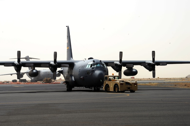 A C-130H Hercules is towed on the flightline at an undisclosed location in Southwest Asia April 24, 2017. The Aircraft, which is assigned to the 103rd Airlift Wing, delivers cargo and personnel downrange in support of Operation Inherent Resolve. (U.S. Air Force photo/Tech. Sgt. Kenneth McCann)