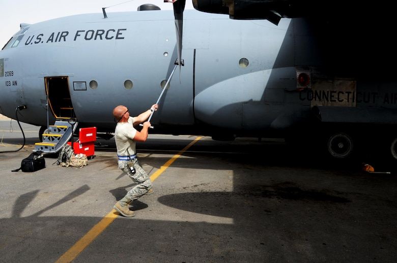 Staff Sgt. James Srackangast, 386 Expeditionary Air Maintenance Squadron crew chief, checks a C-130H Hercules propeller April 24, 2017, at an undisclosed location in Southwest Asia. Srackangast is deployed from the 143rd Airlift Wing in Charlotte, N.C. in support of Operation Inherent Resolve.   (U.S. Air Force photo/Tech. Sgt. Kenneth McCann)